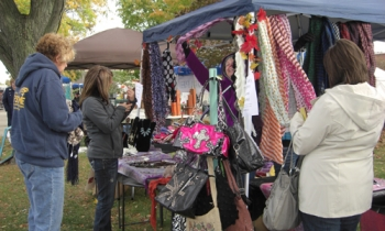 Shoppers peruse vendor booths at Spoon River Drive