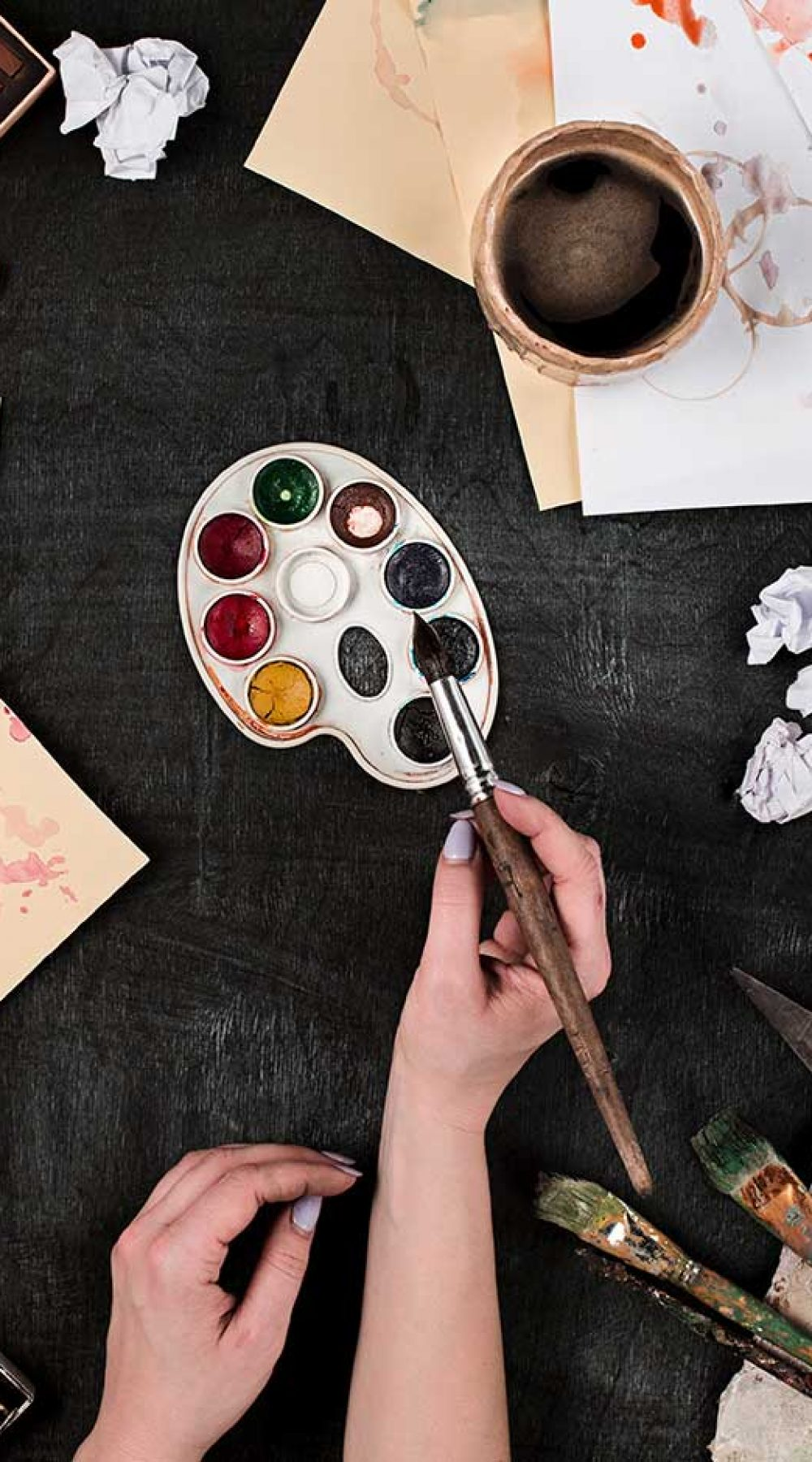 paint-brushes-and-tubes-of-oil-paints-on-wooden-ba-small.jpg